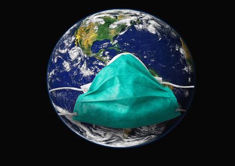 Weltkugel mit Atemschutzmaske